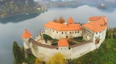 sunny side up : Beautiful aerial autumn landscape around Lake Bled with the castle at Slovenia