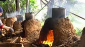 çiftçilik : Taoyuan City, DEC 25: Cooking with char kiln and a pot in a farming resort on DEC 25, 2018 at Taoyuan City, Taiwan Stok Video