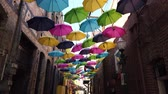 ハング : Colorful umbrellas hanging in the famous Orange Street Alley at Redlands, California