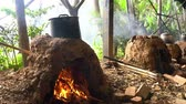 cocinando : Cooking with char kiln and a pot in a farming resort at Taoyuan City, Taiwan