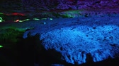 The beautiful Seven Star cave with colorful lights and reflection at Seven-star Crags Scenic Area, Zhaoqing, China