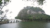 sete : Seven star bridge, mountains around Seven-star Crags Scenic Area at Zhaoqing, China Vídeos