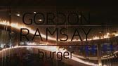 cena urbana : Los Angeles, MAY 15:  Sign of the famous Gordon Ramsay burger restaurant on MAY 15, 2019 at Los Angeles, California Stock Footage