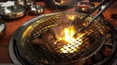 pork meat : 4K Video of delicious Korean style Barbecue meat ate at Kang Hodong Baekjeong, Los Angeles, California