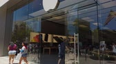 Glendale, JUN 30: Walking towards the Apple store in Americana at Brand shopping mall on JUN 30, 2019 at Glendale, Los Angeles County, California