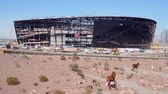 távozás : Las Vegas, DEC 17:  Construction site of the Allegiant Stadium and strip view on DEC 17, 2019 at Las Vegas, Nevada