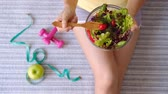 forchetta : Young woman eating homemade healthy salad at home, Healthy lifestyle, diet concept