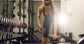 Focused fit woman training lats and lifting weights in fitness gym Stock Footage