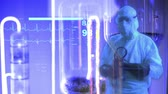 gelecek : doctor in front of a bright background turns into a holographic display