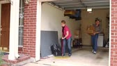 süpürge : Mature couple working to clean the garage.