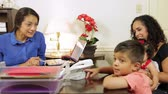 księgowa : Cheerful CEO or small business owner makes client and her children feel welcome. Wideo