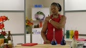 üzlet : A lovely African American woman owner of a small business experiences some pain in her shoulder. Stock mozgókép