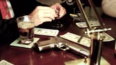 automat : film noir gangster looking at diamonds on his desk