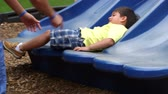 игривый : A cute Hispanic child slides down a playground slide then happily runs off scene to the next activity. Стоковые видеозаписи