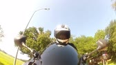 jezdec : View from a camera attached to the front fender of the motorcycle up to the motorcyclist.