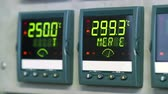 электроника : Information blinks and changes on the LCD digital displays of a control panel.
