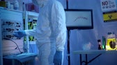 tech or scientist wearing hazmat gear in a sterile tent laboratory