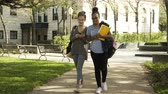 college girls walking on the campus grounds 4k