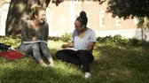 two girls laughing and talking on the college campus 4k Dostupné videozáznamy