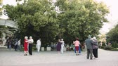 ARMAVIR, RUSSIA - MAY 31, 2017: Elderly people dancing in the Park to the music of street orchestra Стоковые видеозаписи