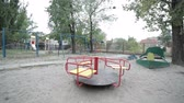 доступность : On the playground, the swing is lonely, children are not in the park.