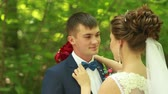 The Bride Fixing Groom`s Bow Tie