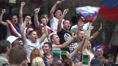 MOSCOW, JULY 1, 2018. Football fans watch the match and support their team at the Nikolskaya Street. The period of the International FIFA World Cup 2018 in Russia.