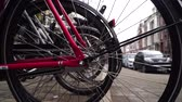 Bikes parking in Amsterdam.wheel close-up