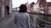 belgie : girl walks and looks at attractions in the city of Bruges Belgium. slow motion