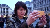 belga : Lady tourist takes pictures on , Belgium.slow motion. dolly zoom effect