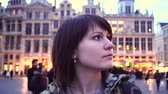 hala : Tourist girl walks and looks at attractions on Grand-Place in Brussels, Belgium