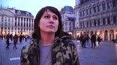 belga : Tourist girl walks and looks at attractions on Grand-Place in Brussels, Belgium
