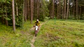 riders : Enduro motorcyclist riding alone in remote woods. Aerial wiew