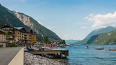 Pertisau, Austria - July 11, 2015: Time lapse Pertisau Achen Boulevard in Austria with people, sailboats and swimmers. Dostupné videozáznamy