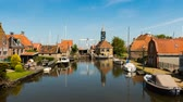 Hindeloopen, The Netherlands - May 21, 2015: Time lapse or hindeloopen with bridge and boats in the Netherlands.