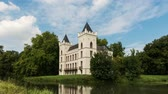 Werkhoven, The Netherlands - August 21, 2015: Time lapse of castle Beverweerd in Werkhoven with canoes passing by on the Rhine curve fit. Dostupné videozáznamy
