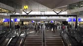 mimari : Rotterdam, The Netherlands - March 10, 2017: Interior of modern railway station Rotterdam with travelers in hall, stairs, escalator and information screens in the Netherlands.