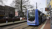 viagem por estrada : Rotterdam, The Netherlands - March 10, 2017: RET tram arriving in Rotterdam city, the Netherlands