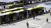 hollanda : Utrecht, The Netherlands - March 23, 2017: Bus station with yellow buses and travelers near central railway station of Utrecht, The Netherlands. Stok Video