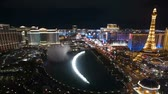 gamble : Editorial time lapse clip of the famous fountains between Bellagio and Paris resorts on the Las Vegas strip.