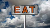 rez : Vintage eat sign with moving clouds time lapse.