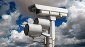 korumalı : Traffic signal security camera with time lapse clouds.