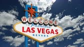 tabela : Welcome to fabulous Las Vegas sign with churning clouds time lapse.