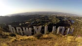 stráň : Los Angeles, California, USA - April 4, 2015:  Clear morning cityscape view behind the famous Hollywood sign in Los Angeless Griffith Park.