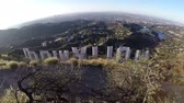 stráň : Los Angeles, California, USA - April 4, 2015:  Moving view behind the famous Hollywood sign in Los Angeless Griffith Park. Dostupné videozáznamy