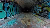 yeraltı : Simi Valley, California, USA - April 11, 2015:  Graffiti covered tunnel walls under the ten lane 118 freeway near Los Angeles in Southern California. Stok Video