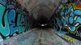 atık : Simi Valley, California, USA - April 11, 2015:  Graffiti covered tunnel under the ten lane 118 freeway near Los Angeles in Southern California. Stok Video