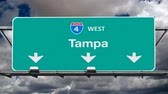 tampa : Tampa Florida Interstate 4 freeway sign with time lapse sky.