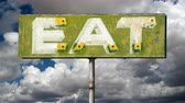 rota : Vintage eat sign with moving clouds time lapse.