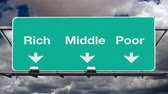 nuvens : Rich, middle or poor freeway interchange sign with time lapse storm clouds.